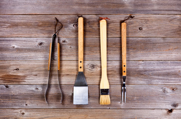 Used kitchenware for barbecue cooking on rustic wood