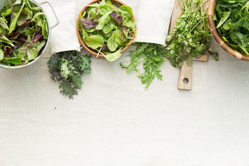 leafy greens on a linen tablecloth