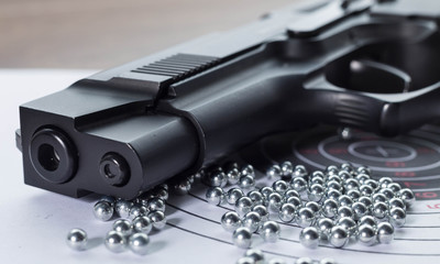 The muzzle of the air pistol and a lot of bullets closeup