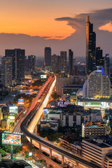 View of The Midtown Bangkok City with Car trail Light in the Sun