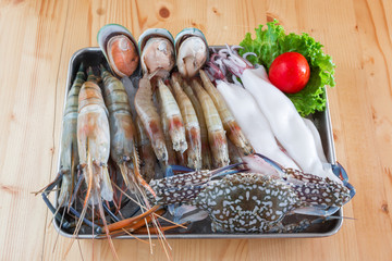 Delicious fresh seafood on wood table, healthy food, or cooking