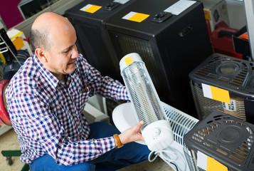 Customer buying small heater
