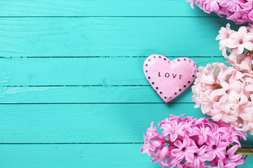 Fresh hyacinths  and  decorative heart with word love on it  on