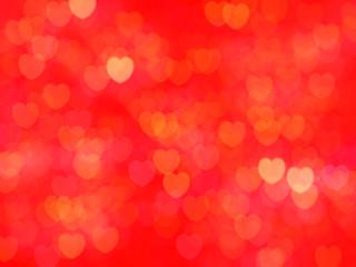 Red hearts wallpaper background. Defocused bokeh glitter.