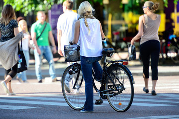 Fototapete - Close up of bike and bicyclist in summer city