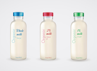 Set of glass bottles with milk. Reduced fat milk. Organic milk.