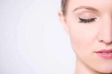 Beautiful woman face, light makeup.