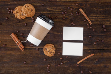 Business card and coffee cup on the wooden table