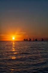 Sailboat on the sea, golden sunset