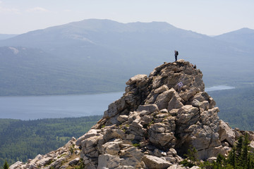 Man on top of the high mountain