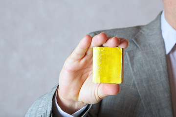 A tiny dictionary in the hand of a man