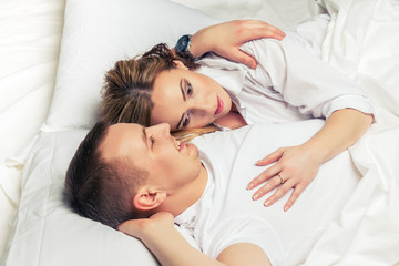 Young couple lying in bed.