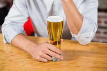 Masculine arms holding a beer