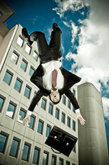 flying businessman lost his suitcase in a urban landscape