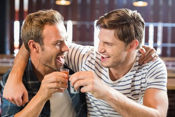 Men toasting with shots