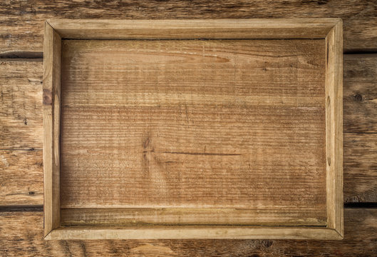Wooden tray on the wooden table top view