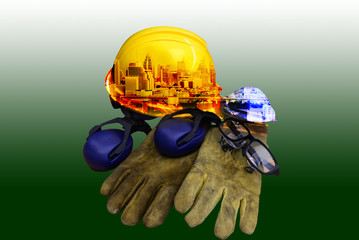 Used safety equipment on green background.