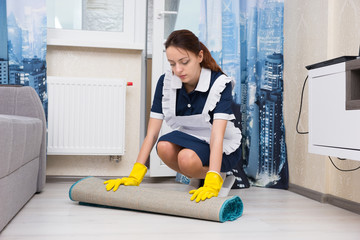 Young woman doing the housekeeping
