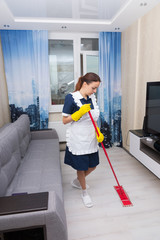 Housekeeper cleaning a hotel suite