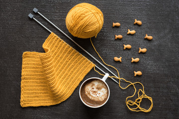 Knitting, cup of coffee and fish crackers
