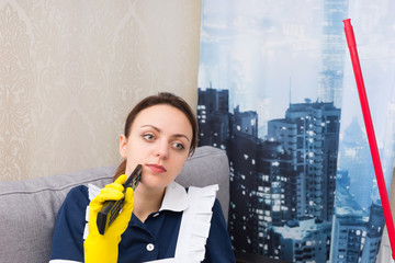 Thoughtful housekeeper in a high-rise apartment