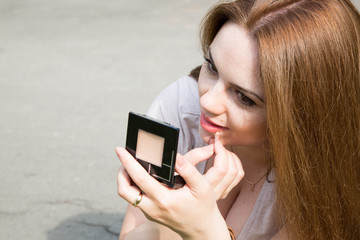 Young attractive woman is preparing for a photo session