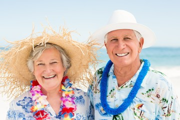 Senior couple standing at the beach