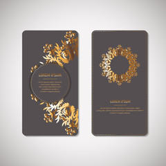 Set of two ornamental gold cards, flyers with flower oriental mandala on grey background. Ethnic vintage pattern. Indian, asian, arabic, islamic, ottoman motif. Vector illustration.