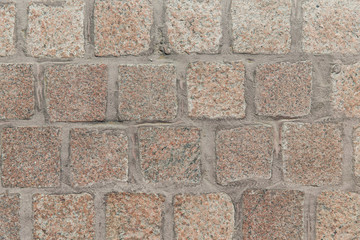 close up of paving stone or facade tile texture