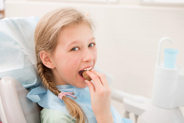 Young girl at dentist., dental treatment
