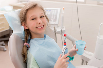 Young girl at dentist., dental treatment