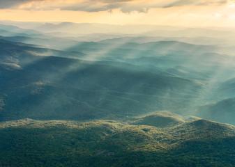 Vibrant horizontal landscape, foggy mountains. Fototapete