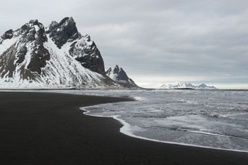 Stokksnes Peninsula, Vestrahorn mountains and black sand ocean coast line, Iceland