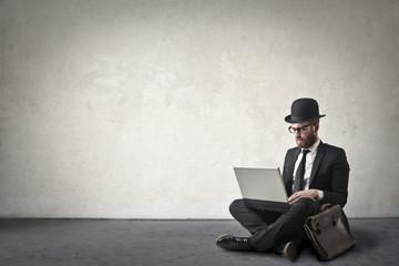 Businessman sitting on the ground