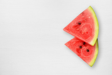 Watermelon slices on white table
