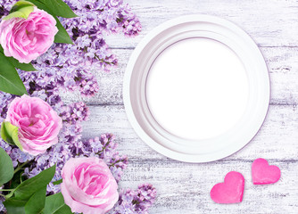 Lilac flowers with roses and photo frame and two hearts