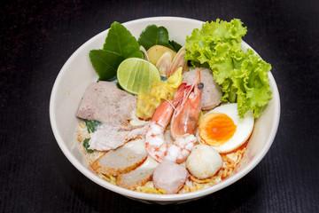 close up. thai noodle mix pork and seafood (shrimp, pork dumplin