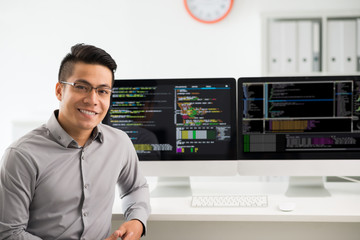 Portrait of smiling young Vietnamese software engineer