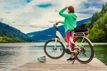 woman with e-bike resting beside a beautiful lake-e-power 21