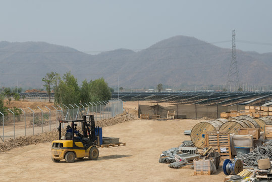 The fork lift in the outdoor warehouse of solar farm