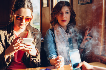 Teenage girls in a cafe