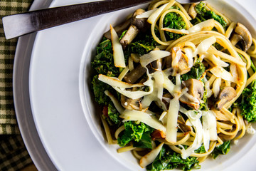 Homemade linguine with kale, mushrooms and muenster cheese