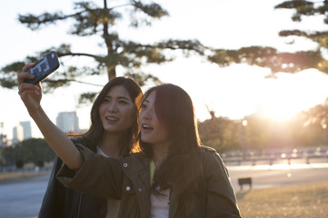 Two young women are taken with a smartphone
