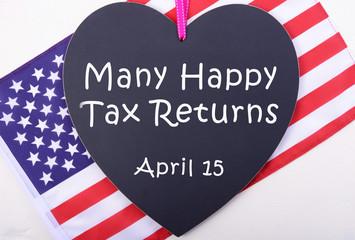 USA Tax Day blackboard and flag.