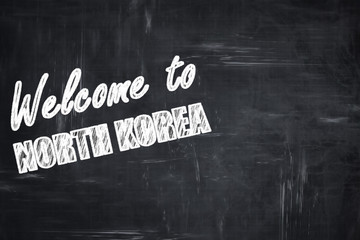 Chalkboard background with chalk letters: Welcome to north korea