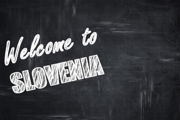 Chalkboard background with chalk letters: Welcome to slovenia