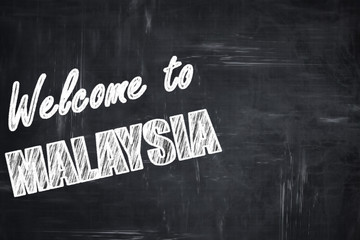 Chalkboard background with chalk letters: Welcome to malaysia