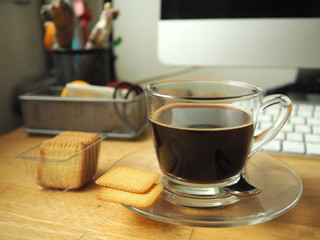 coffee with cracker on working table