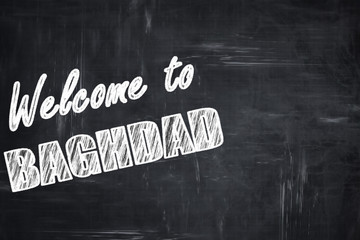 Chalkboard background with chalk letters: Welcome to baghdad