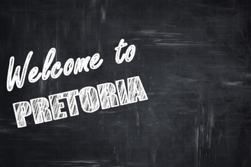 Chalkboard background with chalk letters: Welcome to pretoria